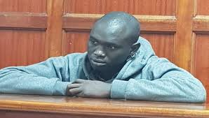 GUARD SUSPECTED TO HAVE KILLED UNIVERSITY STUDENT ARRAIGNED